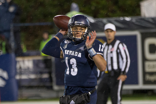 Nevada quarterback Cristian Solano (13) passes the ball agianst Hawaii in the second half of an NCAA college football game in Reno, Nev., Saturday, Sept. 28, 2019. (AP Photo/Tom R. Smedes)