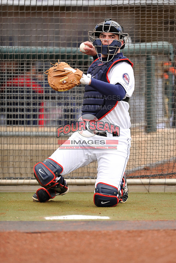 Mitch Garver #25 of the Cedar Rapids Kernels warms up the pitcher prior to the game against the Kane County Cougars at Perfect Game Field on May 1, 2014 in Cedar Rapids, Iowa. The Kernels won 5-2.   (Dennis Hubbard/Four Seam Images)