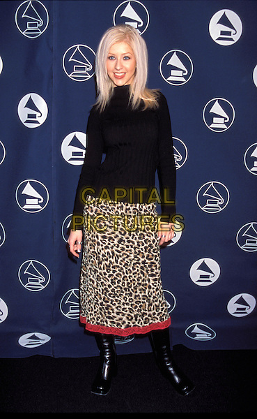 CHRISTINA AGUILERA.black polo neck jumper, leopard print skirt, knee high boots full length.Ref: 9619  .CAP/JPI/LR.©LR /JPI/Capital Pictures..