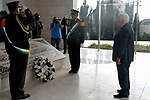 Palestinian President Mahmoud Abbas lays a wreath on the grave of late Palestinian leader Yasser Arafat on the first day of Eid al-Adha, in the West Bank city of Ramallah on September 1, 2017. Photo by Osama Falah