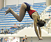 Camille Roberts of Cold Spring Harbor soars through the air during the Nassau County girls' diving championship and state qualifier at Nassau Aquatic Center on Wednesday, November 4, 2015. She won the competition and qualified for states with a total score of 449.85.<br /> <br /> James Escher