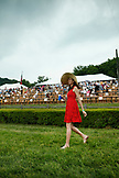 USA, Tennessee, Nashville, Iroquois Steeplechase, a woman crosses the track in between races