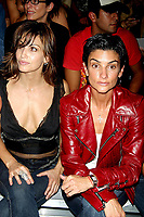GINA GERSHON AND INGRID CASARES  2003 <br /> MERCEDES-BENZ FASHION WEEK-<br /> MARC JACOBS 2004 SPRING COLLECTION.<br /> NEW YORK CITY.<br /> Photo By John Barrett/PHOTOlink.net