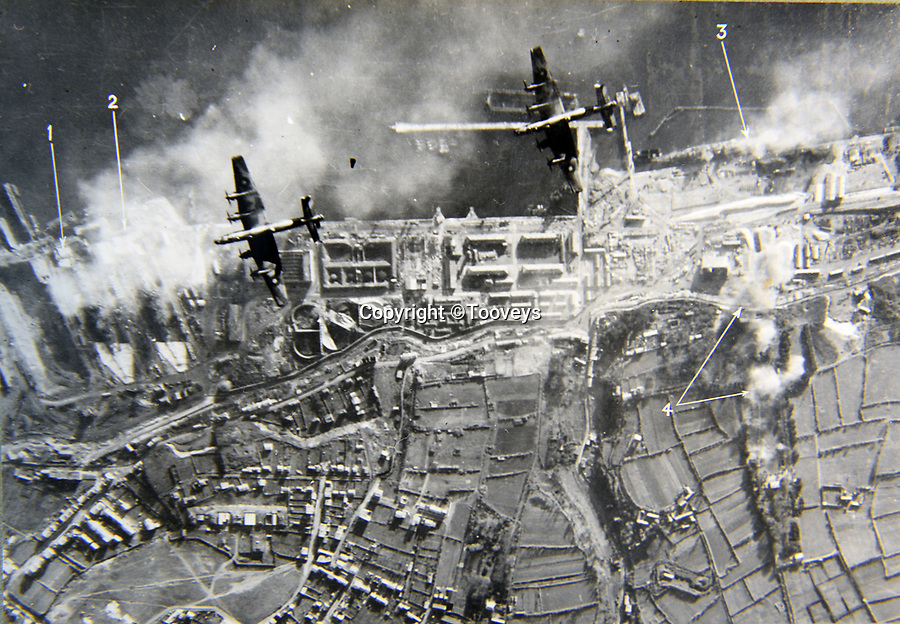 BNPS.co.uk (01202 558833)<br /> Pic:  Tooveys/BNPS<br /> <br /> Taken on 18/12/41 at Brest, France.  Two Halifax bombers coming in to attack the battlecruiser Scharnhorst (1).<br /> <br /> Dramatic photos showing a series of heart-pounding World War Two bombing raids from the pilot's perspective have come to light.<br /> <br /> They were taken from Blenheim bombers undertaking attacks on targets in Germany and Nazi-occupied Netherlands in 1941.<br /> <br /> Several capture the immediate aftermath of a direct hit, with flames and clouds of smoke signifying they had achieved their aim.<br /> <br /> The album, which contains almost 100 photos, has emerged for sale with Toovey's Auctions, of Washington, west Sussex.