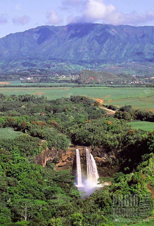 Wailua Falls and Mt. Waialeale, east Kauai, with misty waterfall rainbow, aerial photo.