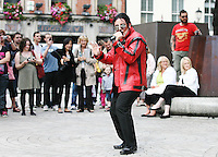 NO REPRO FEE. 19/6/2010. MAN IN THE MIRROR Flash Mob. Irelands leading Michael Jackson impersonator Anthony Walker with 8 year old Dylan Tierney and zombies are pictured at the Central Bank, Dame St, Dublin recreating the classic Thriller video MAN IN THE MIRROR a musical tribute to Michael Jackson returns in June for 'The Anniversary Tour' with a special show dedicated to the 'King of Pop'. Opening night is on Michael's first anniversary June 25th at Dublin's Olympia Theatre. Tickets are on sale now priced EUR25.00 inclusive of booking fee. Picture James Horan/Collins Photos