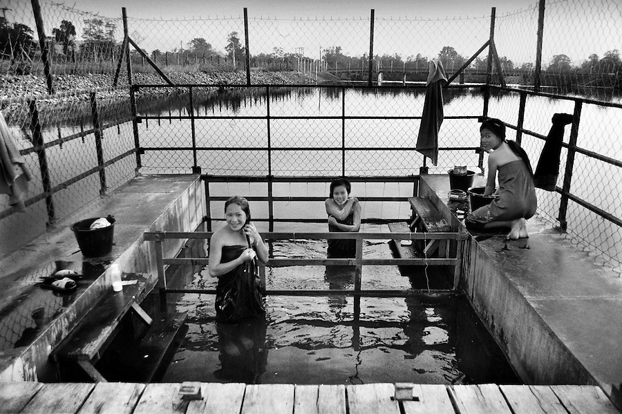 "Mekong Dam Victims - Laos. Following the drownings caused by the regulation pond, the THPC has banned the access to the river in this area. As a compensation the company has constructed cages for the villagers where they can take a secure bath in the river. After the construction of the Theun-Hinboun Dam in Laos more than 29,000 people in 71 villages have lost fisheries, rice fields, vegetables gardens and fresh drinking water supplies as a result of the dam. An expansion project is currently under construction and will displace another 4,200 mostly indigenous people from their lands in the reservoir area and displace or negatively affect another 50,000 people living downstream, on project construction lands, and in resettlement host villages. Known as ""The Mother of Waters"", more than 60 million people depend on the Mekong river and its tributaries for food, fresh water, transport and other aspects of daily life. The construction of big dams is now threatening the life of these people aswell as the vital and unique ecosystem of the river."