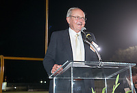 Ted Tiffany '57 accepts the Athletics Hall of Fame award. Alumni, family, staff and students at the Occidental College Athletics Hall of Fame event, part of Homecoming weekend, Oct. 24, 2014 on Patterson Field. (Photo by Marc Campos, Occidental College Photographer)