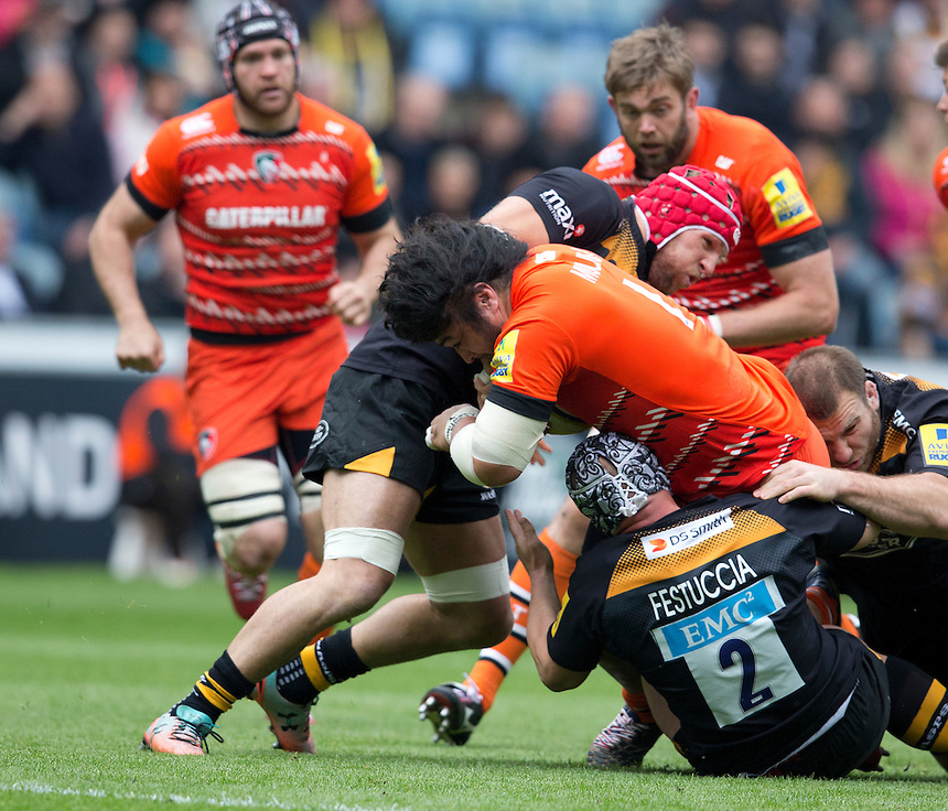 Leicester Tigers' Logovi'i Mulipola brought down by Wasps' James Haskell and Carlo Festuccia<br /> <br /> Photographer Stephen White/CameraSport<br /> <br /> Rugby Union - Aviva Premiership - Wasps v Leicester Tigers - Saturday 9th May 2015 - Ricoh Arena - Coventry<br /> <br /> &copy; CameraSport - 43 Linden Ave. Countesthorpe. Leicester. England. LE8 5PG - Tel: +44 (0) 116 277 4147 - admin@camerasport.com - www.camerasport.com