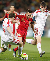 Spain's Santi Cazorla (c) and Belarus' Sergei Balanovich (l) and Stanislav Dragun during 15th UEFA European Championship Qualifying Round match. November 15,2014.(ALTERPHOTOS/Acero) /NortePhoto nortephoto@gmail.com