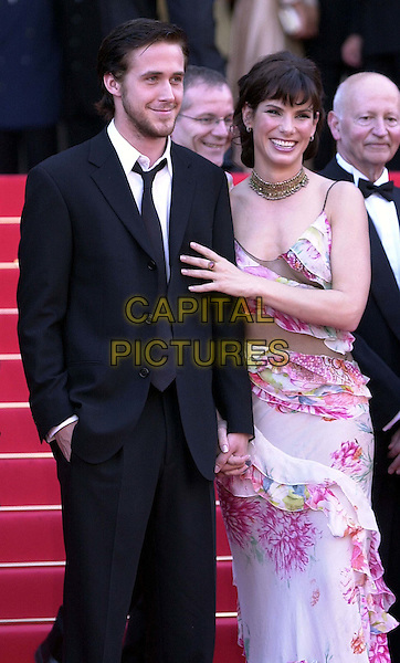 "SANDRA BULLOCK & co-star..""Murder by Numbers"". Cannes Film Festival, France..half length, half-length, floral print dress, touching, red carpet..www.capitalpictures.com..sales@capitalpictures.com..©Capital Pictures"