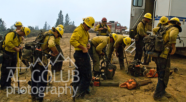 Greeley Hill, California-- July 30, 2008-Telegraph Fire-Wildfires Threaten Yosemite National Park.Santa Barbara County Hot Shot fire Crew prepare to cut fire line on Division L.  Division L is on the leading edge of the fire and is threatening Greeley Hill..Photo by Al GOLUB/Golub Photography