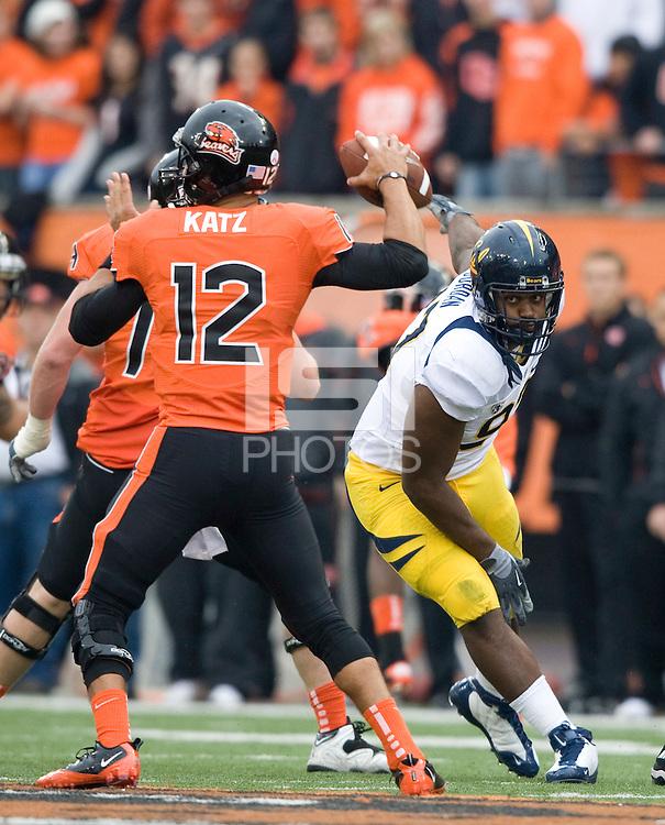 Cameron Jordan of California puts a lot of pressure on Oregon State quarterback Ryan Katz during the game at Reser Stadium in Corvallis, Oregon on October 30th, 2010.   Oregon State defeated California, 35-7.