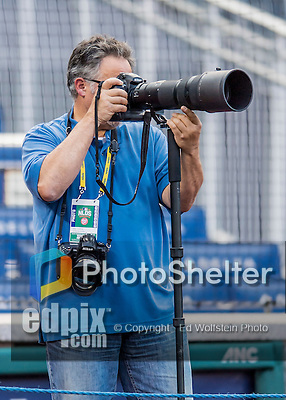 13 October 2016: Photographer Mark Goldman works batting practice prior to the NLDS Game 5 between the Washington Nationals and the Los Angeles Dodgers at Nationals Park in Washington, DC. The Dodgers edged out the Nationals 4-3, to take Game 5 of the Series, 3 games to 2, and move on to the National League Championship Series against the Chicago Cubs. Mandatory Credit: Ed Wolfstein Photo *** RAW (NEF) Image File Available ***