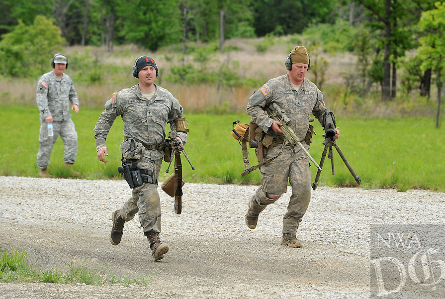 NWA Democrat-Gazette/Michael Woods --04/23/2015--w@NWAMICHAELW... The sniper team of Spc. Allen Nelson (left) and Sgt. Jeremy Henrich with the 113th Cavalry run to their first positions during Thursdays sniper competition at Fort Chaffee.  23 sniper teams are competing in the national Winston P. Wilson Sniper Championship from Monday through Friday at Fort Chaffee. Sniper teams include participants from Germany, Canada, Denmark, the National Guard and the active-duty Army and Marine Corps.  Thursday  the teams will participated in a contest to test how many targets they can hit at short, medium and long range under stressful conditions.