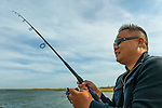 Rev. DAVID YI, of Douglaston, Queens, is fishing on the pier of Levy Park & Preserve during Memorial Day Weekend. The pastor's family and parishoners went to the park because they could not go to Jones Beach to fish, for the parkways were closed after the beach was filled to capacity for the Bethpage New York Air Show.