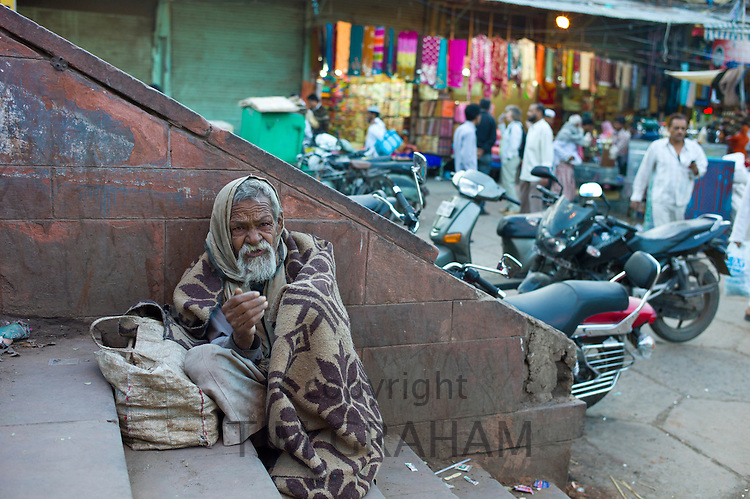 Indian beggar at muslim Meena Bazar, in Old Delhi, India