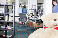 John Fawcett, the CEO and co-founder of Quantopian, speaks with VP of Quant Strategy Jessica Stauth, near their workstations in the offices of Quantopian in the Downtown Crossing area of Boston, Mass., on Wed., June 1, 2016. Quantopian is a Boston-based start-up that provides a platform for building, testing, and executing stock trading algorithms.
