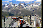 Switzerland, Matterhorn.  <br /> Railroad tracks, hiking trails, bike paths, fences, streams, tree trunks . . . all can form dramatic lines and be used the same way in your images, over and over. Here, I composed with strong lines leading from the very center of the photo.<br /> The Gornergrat train approaching the summit observatory above Zermatt.
