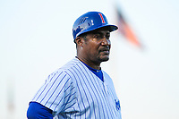 Iowa Cubs hitting coach Mariano Duncan (25) coaches third base during game two of a Pacific Coast League doubleheader against the Colorado Springs Sky Sox on August 17, 2017 at Principal Park in Des Moines, Iowa. Iowa defeated Colorado Springs 6-0. (Brad Krause/Four Seam Images)