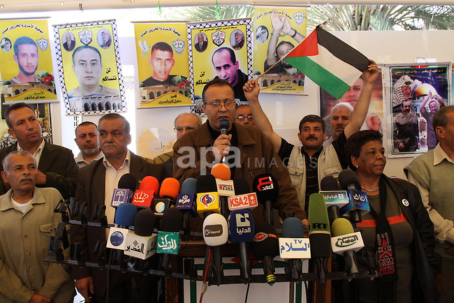 Palestinians Speak during a press conference, as women hold pictures of jailed relatives during a protest in Gaza city calling for their release from Israeli prisons on May 7, 2011. Photo by Mohamad Asad