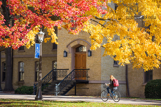 November 7, 2017;  A student rides past Washington Hall on the Main Quad. (Photo by Barbara Johnston/University of Notre Dame)