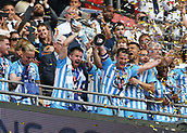 28th May 2018, Wembley Stadium, London, England;  EFL League 2 football, playoff final, Coventry City versus Exeter City; Michael Doyle of Coventry City and Marc McNulty of Coventry City lift the EFL League 2 trophy from the gantry