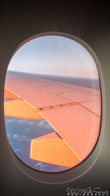 Window seat view during sunset.