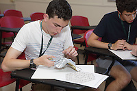 OrigamiUSA 2016 Convention at St. John's University, Queens, New York, USA. Creasers in Byriah Loper's class on his design, Hex Pentagons Tessellation.