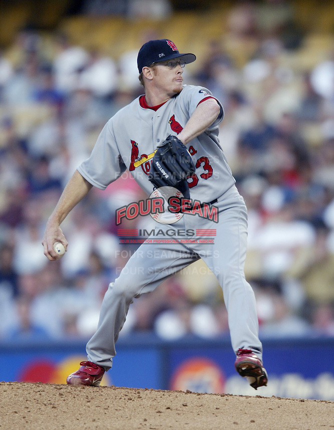 Travis Smith of the St. Louis Cardinals pitches during a 2002 MLB season game against the Los Angeles Dodgers at Dodger Stadium, in Los Angeles, California. (Larry Goren/Four Seam Images)