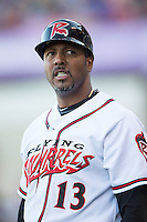 Richmond Flying Squirrels manager Jose Alguacil (13) coaches third base during the Eastern League game against the Bowie Baysox at The Diamond on May 23, 2015 in Richmond, Virginia.  The Baysox defeated the Flying Squirrels 3-2.  (Brian Westerholt/Four Seam Images)