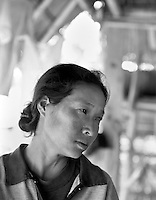An HIV positive woman cries in her home near Chiang Mai in northern Thailand on October 4, 2000.  Worldwide, more than 20 million people have died since the first cases of AIDS were identified in 1981.