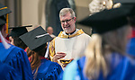 The Rev. Dennis H. Holtschneider, C.M., president of DePaul University, offers communion as students gather with their friends and family members at the Saint Vincent de Paul Parish Church on DePaul University's Lincoln Park Campus for the annual Baccalaureate Mass Friday, June 9, 2017. The event was part of the 119th commencement ceremonies for the Chicago university. (DePaul University/Jamie Moncrief)