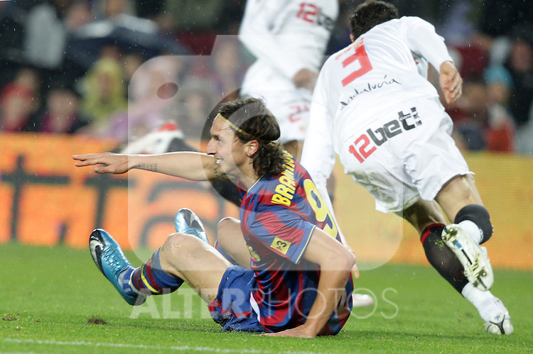 Football Season 2009-2010. Barcelona's player Zlatan Ibrahimovic (L) and Sevilla's  Drago (R) during their spanish liga soccer match at Camp Nou stadium in Barcelona. January 16, 2010.