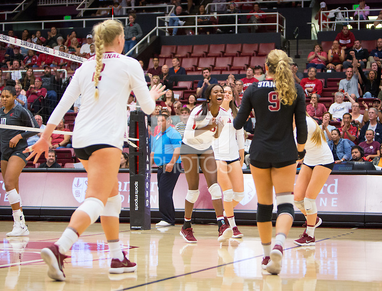 STANFORD, CA - October 12, 2018: Kathryn Plummer, Tami Alade, Morgan Hentz at Maples Pavilion. No. 2 Stanford Cardinal swept No. 21 Washington State Cougars, 25-15, 30-28, 25-12.