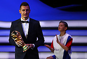 1st December 2017, State Kremlin Palace, Moscow, Russia;  World Cup record goal-scorer Miroslav Klose from Germany carries the World Cup trophy to the stage as the representative of the current world champion during the FIFA 2018 World Cup draw, at the State Kremlin Palace in Moscow, Russia, 01 December 2017.