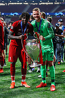 Divock Origi of Liverpool and Simon Mignolet of Liverpool celebrate with the trophy after the UEFA Champions League Final match between Tottenham Hotspur and Liverpool at Wanda Metropolitano on June 1st 2019 in Madrid, Spain. (Photo by Daniel Chesterton/phcimages.com)<br /> Foto Daniel Chesterton PHC/ Insidefoto <br /> ITALY ONLY