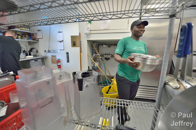 Washikala Lupembe, a refugee from the Democratic Republic of the Congo, works in a restaurant in Durham, North Carolina, where he and his family were resettled with assistance from Church World Service.<br /> <br /> <br /> Photo by Paul Jeffrey for Church World Service.