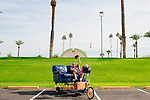 """Jerry Zwack, 62, created a motorized couch that he now drives around Sun City because his wife jokingly called him a """"couch potato"""" who needed to get out of the house. He said his odometer now reads more than 3,000 miles. He poses with his one-of-a-kind transportation outside of the Sun Bowl Amphitheater in Sun City, Arizona December 1, 2013."""