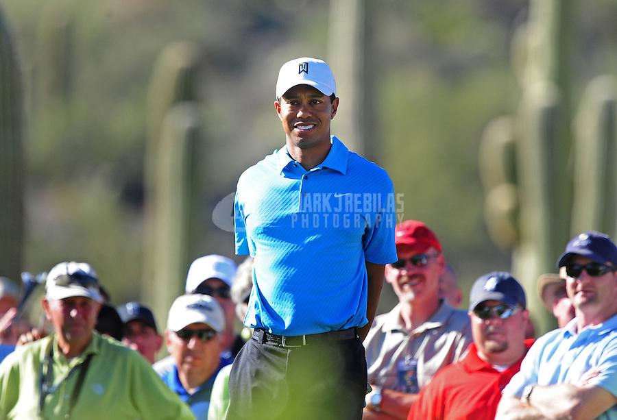 Feb 25, 2009; Marana, AZ, USA; Tiger Woods on the fifteenth tee box against Brendan Jones (not pictured) during the first round of the World Golf Championships-Accenture Match Play Championship at the Ritz-Carlton Golf Club, Dove Mountain. Woods defeated Jones in 16 holes to advance to the second round. Mandatory Credit: Mark J. Rebilas-