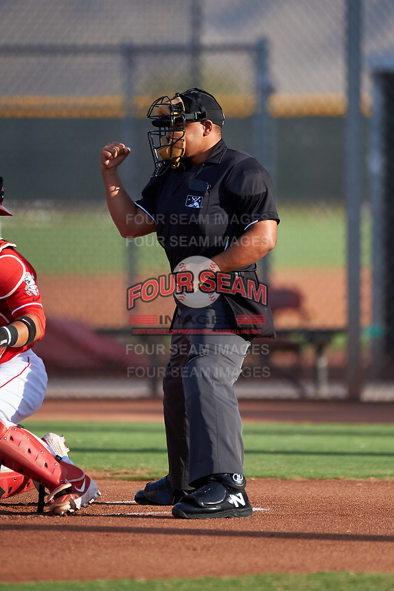 Home plate umpire Sam Clark calls a strike on a batter during an Arizona League game between the AZL Athletics Green and AZL Reds on July 21, 2019 at the Cincinnati Reds Spring Training Complex in Goodyear, Arizona. The AZL Reds defeated the AZL Athletics Green 8-6. (Zachary Lucy/Four Seam Images)