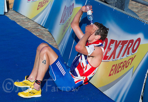 25 AUG 2013 - STOCKHOLM, SWE - Alistair Brownlee (GBR) of Great Britain recovers after winning the men's ITU 2013 World Triathlon Series round in Gamla Stan, Stockholm, Sweden (PHOTO COPYRIGHT © 2013 NIGEL FARROW, ALL RIGHTS RESERVED)