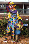 Free standing painting of Slo Poke & Kid in front of the elementary school in Lake Placid