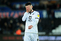 Matt Grimes of Swansea City looks dejected during the Sky Bet Championship match between Swansea City and Millwall at the Liberty Stadium in Swansea, Wales, UK. Saturday 23rd November 2019