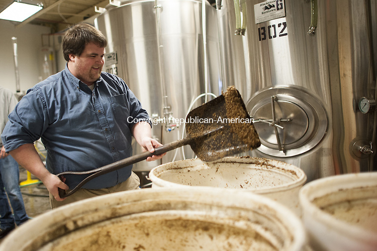WOLCOTT, CT-7 February 2014-020714EC03-   Andrew Fredericksen is a volunteer at Shebeen Brewering in Wolcott. He unloads used grains into giant containers, where a local farmer will make use of them. The brewing company, located along Wolcott Road, has grown quickly in a year and is now canning beers and distributing them to package stores.  Erin Covey Republican-American