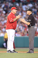 05/29/12 Anaheim, CA: Los Angeles Angels manager Mike Scioscia #14 and umpire Mike Everitt #57 during an MLB game played between the New York Yankees and the Los Angeles Angels at Angel Stadium. The Angels defeated the Yankees 5-1.