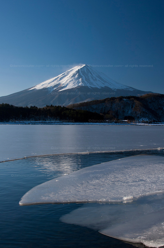 A snow capped Mount Fuji above a frozen Lake Kawaguchiko. Japan, Wednesday February 13th 2008