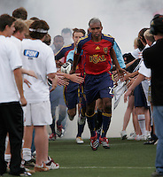 Real Salt Lake's (23) Eddie Pope runs onto the field during pre-game introductions before the Columbus Crew's 1-0 win over Real Salt Lake at Rice Eccles Stadium in Salt Lake City, Utah May 6, 2006