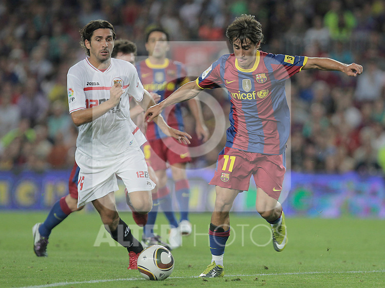 FC Barcelona's Bojan Krkic (r) and Sevilla's Julien Escude (l) during SuperCup of Spain Final match. August 21,2010. (ALTERPHOTOS/Acero)