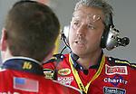 Doug Richert, crew chief for the No. 16 Ford, talks with driver Greg Biffle in the garage area at Daytona International Speedway, in Daytona Beach, Fla., during NASCAR NEXTEL Cup practice, Saturday, Feb. 11, 2006.(AP Photo/Brian Myrick)